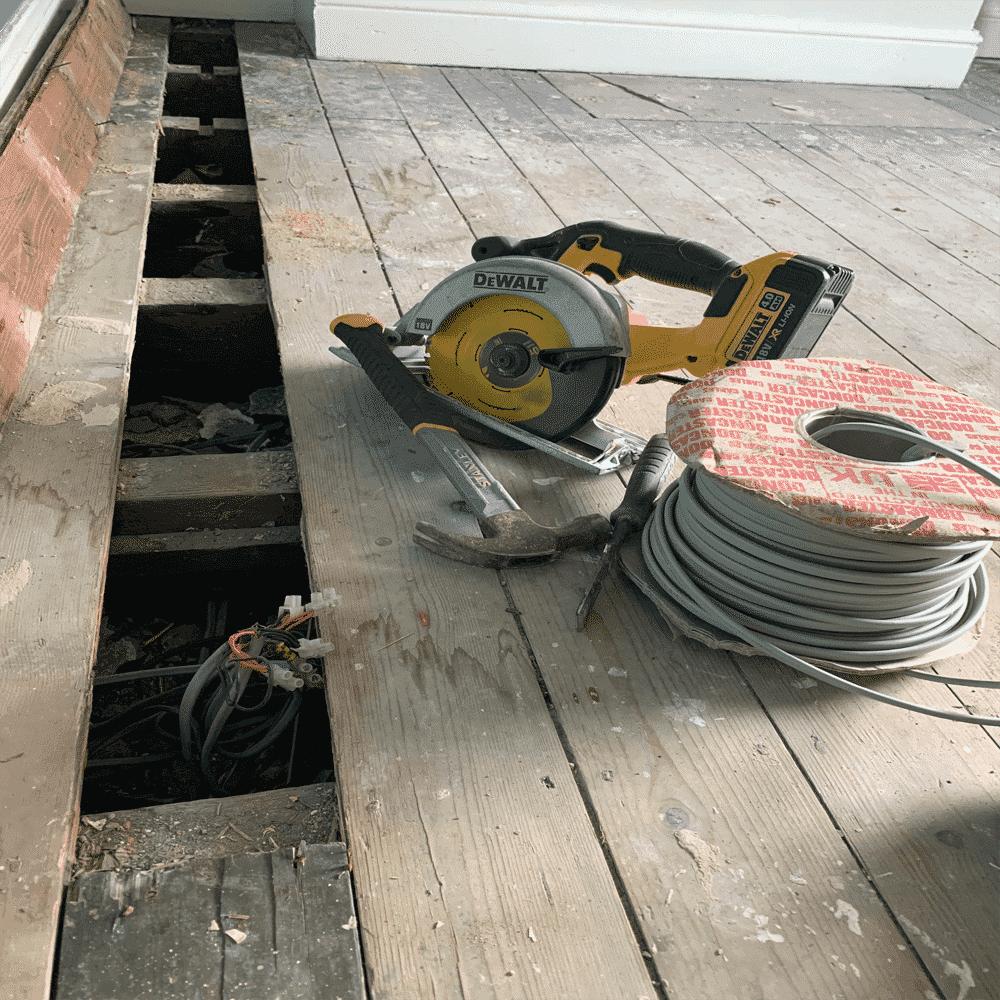 house-rewire-floorboard-access